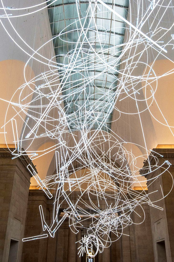 Installation view of Cerith Wyn Evans's Forms in Space…by Light (in Time), commissioned by and first shown at Tate Britain, London, in 2017.