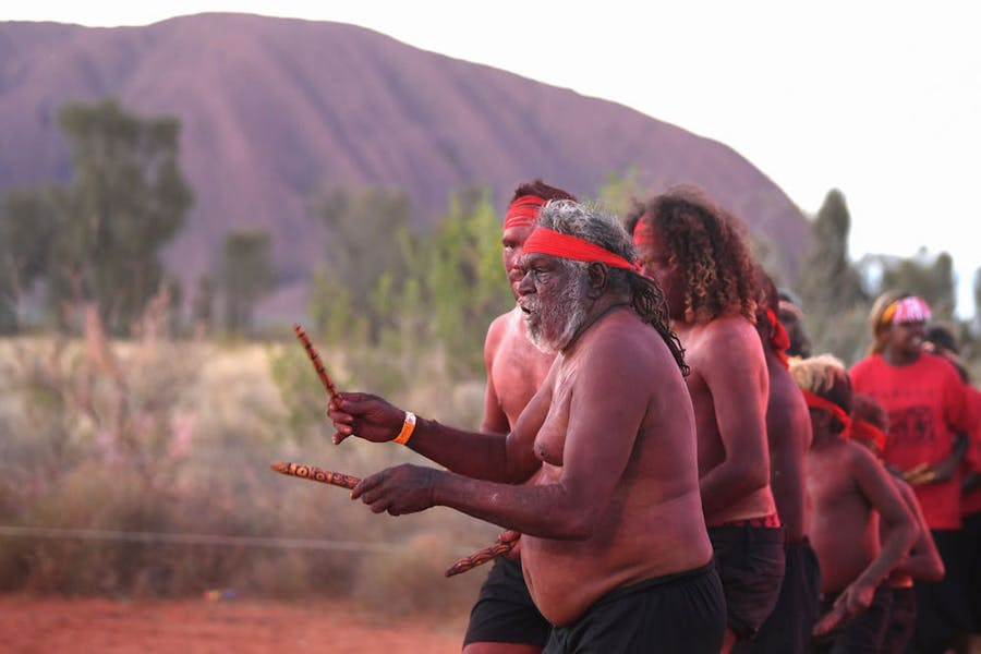 Anangu members perform a dance during a ceremony marking the permanent ban on climbing Uluru on 27 October 2019.
