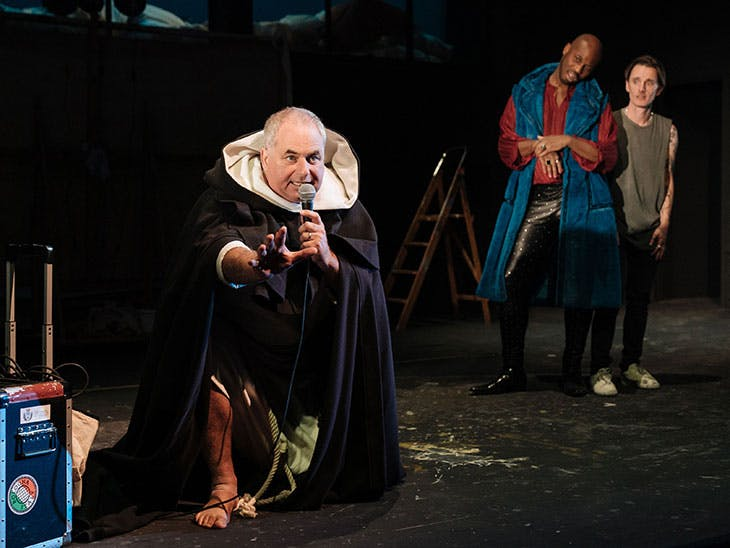 Howard Ward as Girolamo Savonarola, Stefan Adegbola as Poggio di Chiusi, and Dickie Beau as Sandro Botticelli in Botticelli in the Fire at Hampstead Theatre, London, 2019.