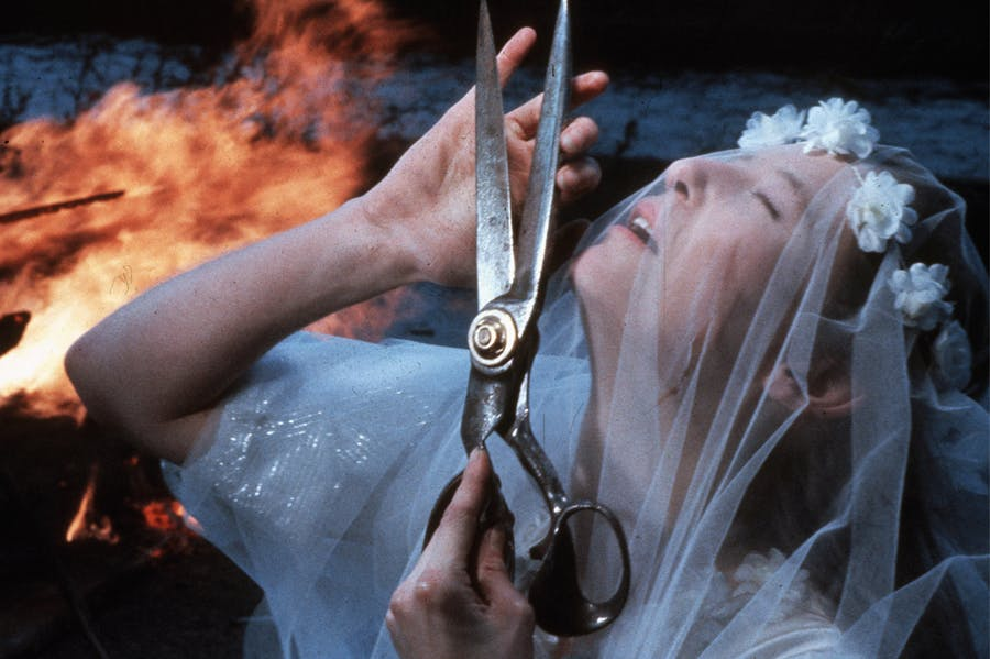 In the final scene of Derek Jarman's film The Last of England (1987), Tilda Swinton's unnamed character destroys her wedding dress on Dungeness Beach.