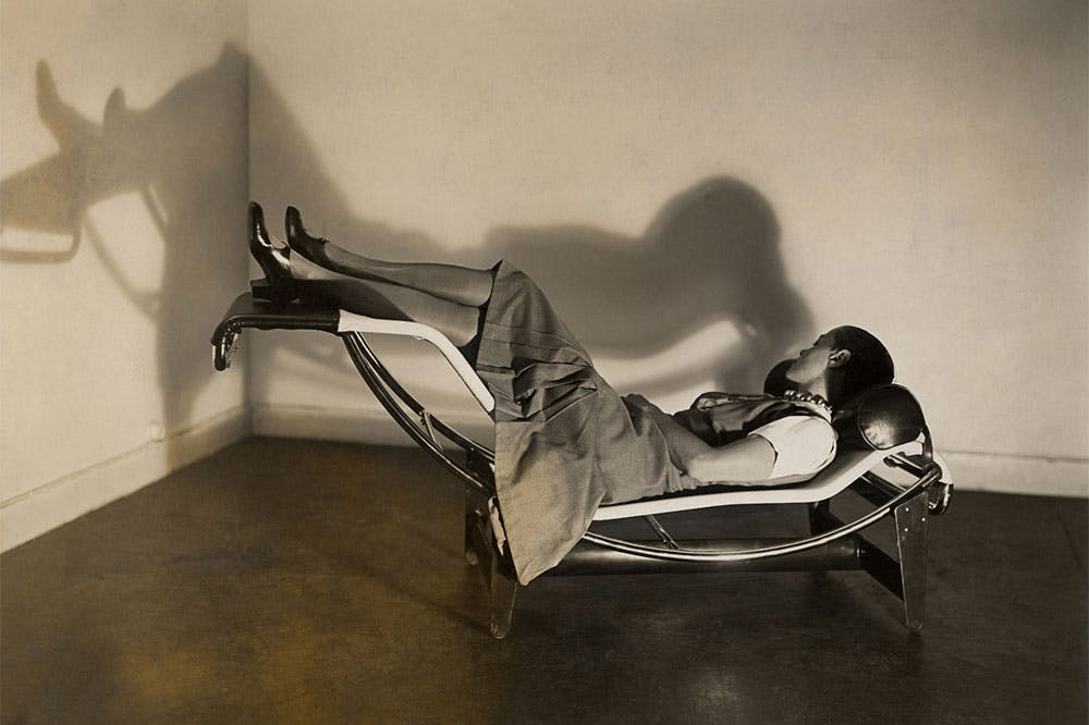 Charlotte Perriand on the 'chaise longue basculante, B306' designed by Perriand, Pierre Jeanneret and Le Corbusier in c. 1928.