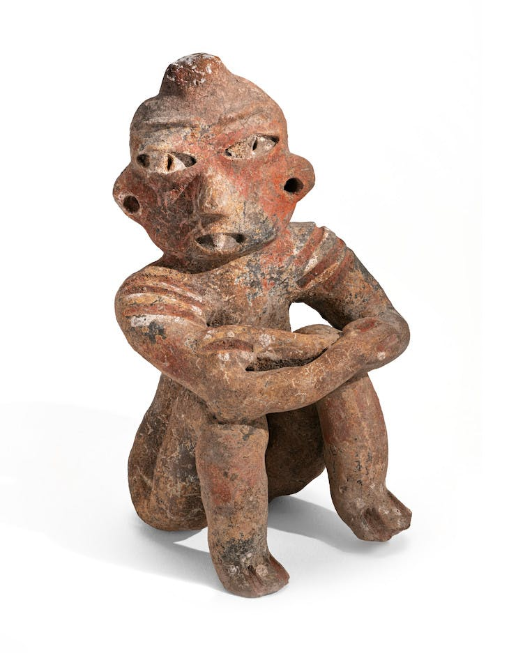 Seated male with shoulder scarification (1200–900 BC), possibly Tlatilco.