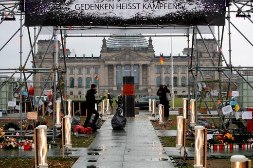 Centre for Political Beauty activists install their work in Berlin in December 2019.