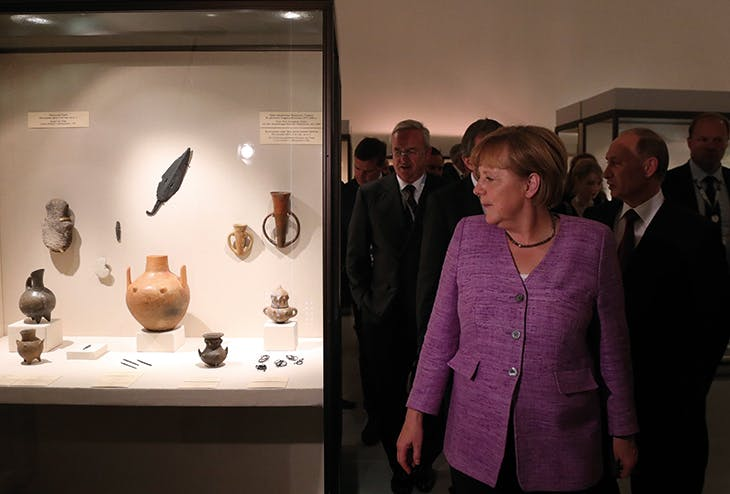 Angela Merkel and Vladimir Putin visiting 'The Bronze Age of Europe: Europe Without Borders' at the State Hermitage Museum in St Petersburg in June 2013.