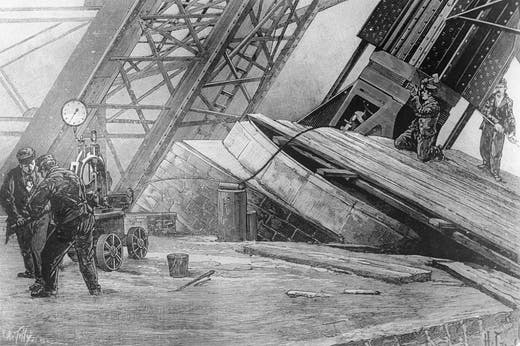 Workmen riveting the bases of the Eiffel Tower in place using hydraulic power in c. 1888.