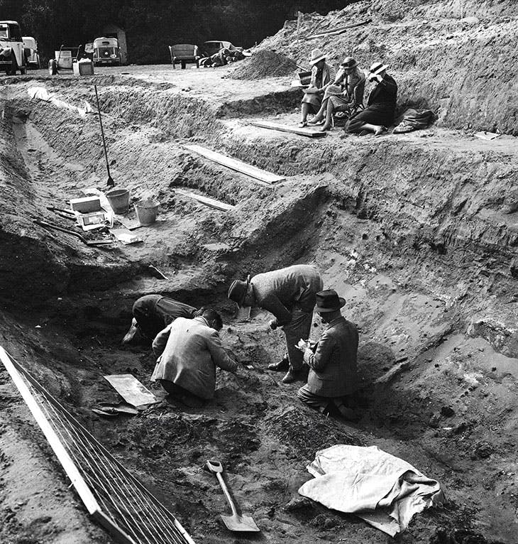 Edith Pretty (in a cane chair) observing the excavations at Sutton Hoo in 1939.