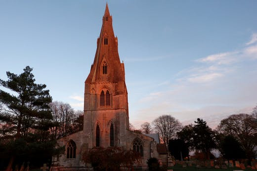 The west steeple of the Parish Church of St Mary in Frampton, Lincolnshire, was finished with one of the country's earliest stone broach spires by c. 1300.