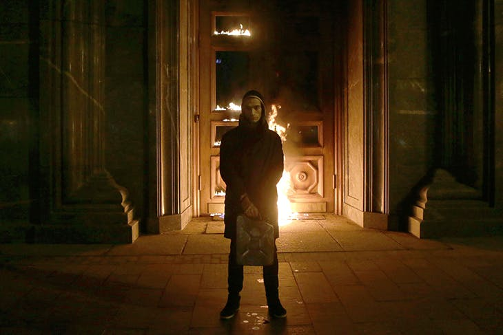 Russian artist Pyotr Pavlensky poses after setting fire to the doors of the headquarters of the FSB security service, the successor to the KGB, in central Moscow early on November 9, 2015. Photo by NIGINA BEROEVA/AFP via Getty Images