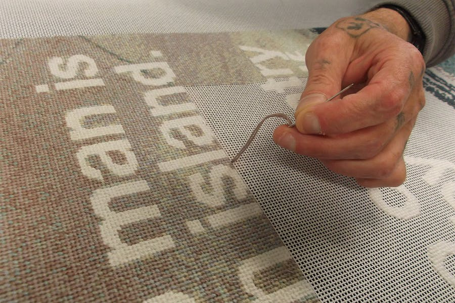 Stitchers working on Wolfgang Tillmans' No Man is an Island (2019).