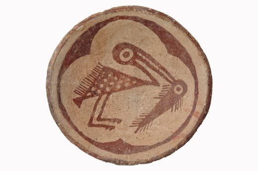 Red-on-buff plate with a bird holding a fish in its beak, c. 900–1150, Sacaton, Arizona. Arizona State Museum