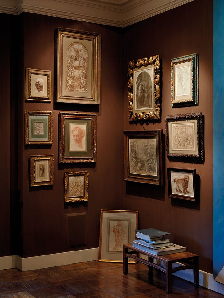 A display of Old Master drawings, including Baccio Bandinelli's red chalk Head of a Woman Wearing a Ghirlanda (centre left)