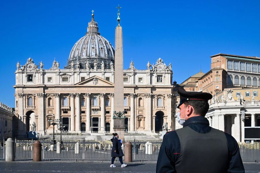 A police officer standing guard in St Peter's Square.