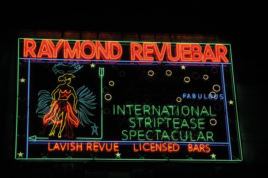 Neon sign made in the 1950s for Raymond Revuebar in Soho, London, photographed in 2015 after restoration and reinstallation.