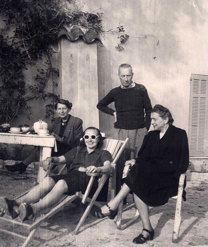 Photograph of (left to right) Sophie Taeuber-Arp, Sonia Delaunay, Jean (Hans) Arp, and a friend in Grasse in 1942.