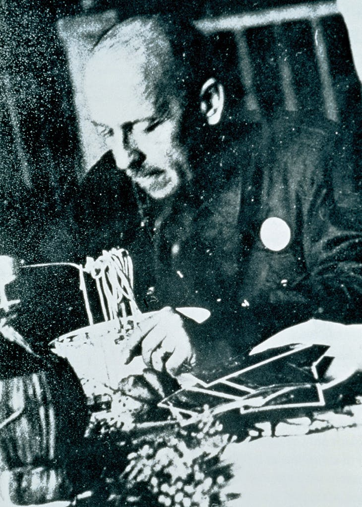Filippo Tommaso Marinetti eating pasta at Biffi, a restaurant in Milan in 1930. The Estorick Collection, London