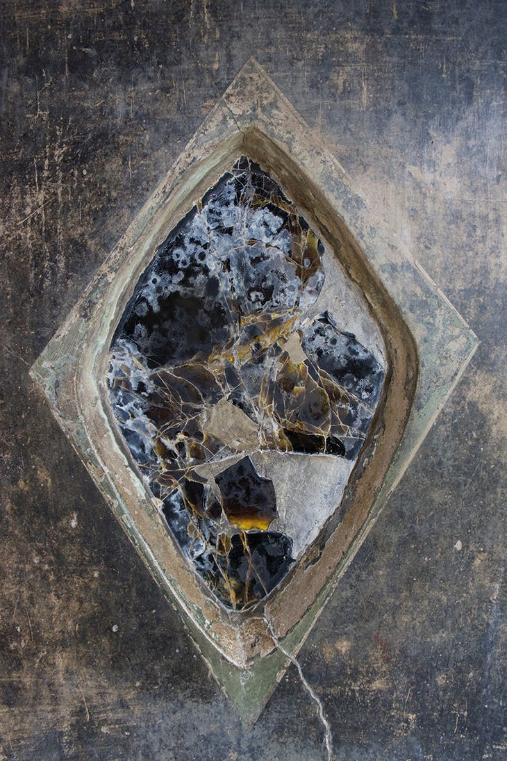 Obsidian mirror in entrance to the peristyle of the House of the Gilded Cupids, Pompeii, 50–79 AD.