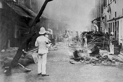 Shropshire Regiment 'Whitewash Brigade' emptying items from Chinese homes in Taipingshan, Hong Kong, and burning them on the street as an epidemic control measure during the 1894 plague outbreak.
