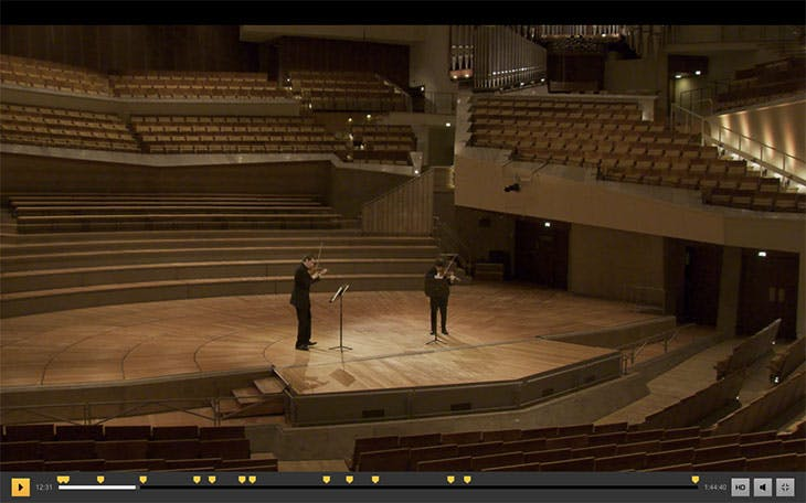 Screenshot showing Episode 3 of the Easter@Philharmonie Festival. Noah Bendix-Balgley and Daishin Kashimoto, first concert masters of the Philharmoniker, play a movement from Prokofiev's Sonata for Two Violins to an empty Philharmonie