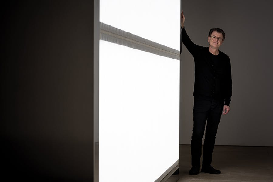 Alfredo Jaar photographed next to his installation 'The Sound of Silence' (2006) at Yorkshire Sculpture Park in October 2017. Photo by Jonty Wilde
