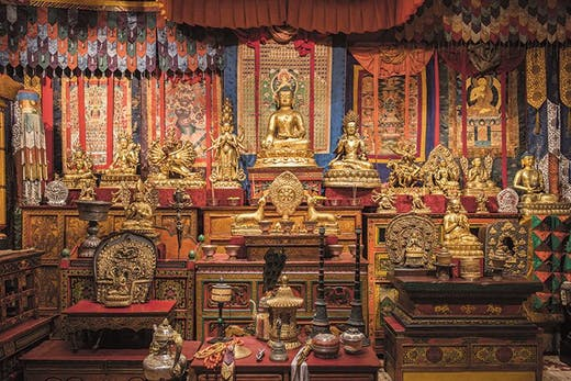 Gilded statues and ritual objects arranged by Alice S. Kandell