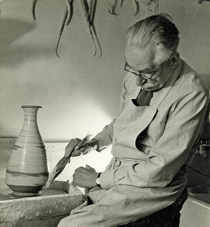 Bernard Leach working at the wheel (1963).