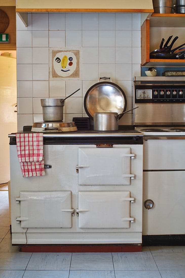 The kitchen at Farleys, East Sussex, with a tile by Picasso above the Aga.