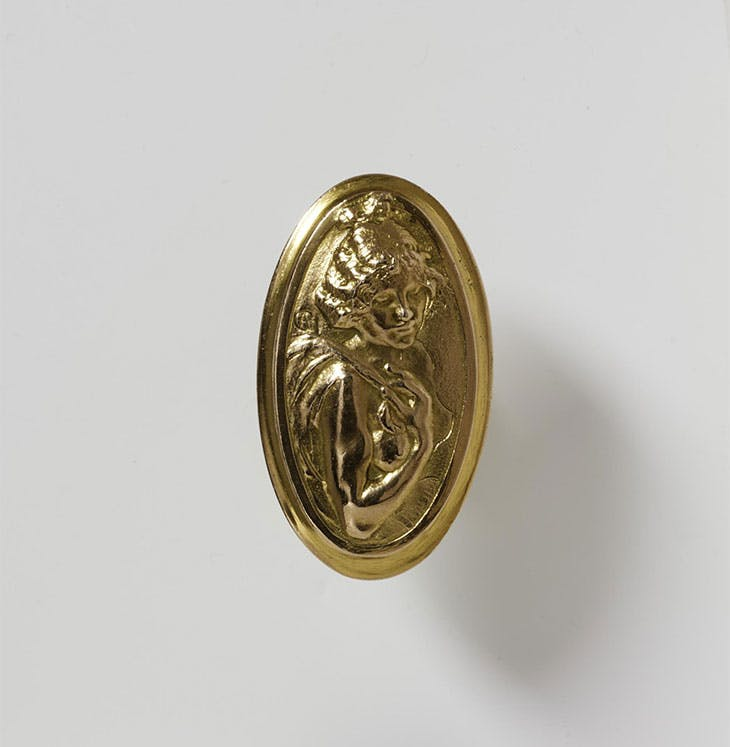 Door handle (c. 1900), designed by Alexandre-Louis-Marie Charpentier; manufactured by Fontaine Frères & Vaillant, Paris. Victoria and Albert Museum, London