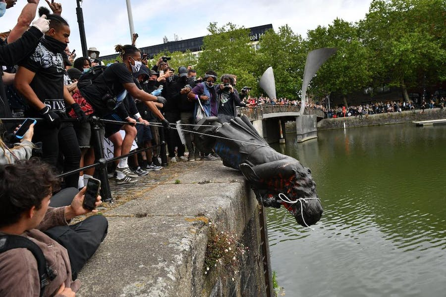 Protesters throwing the statue of Edward Colston into Bristol harbour on 7 June 2020.