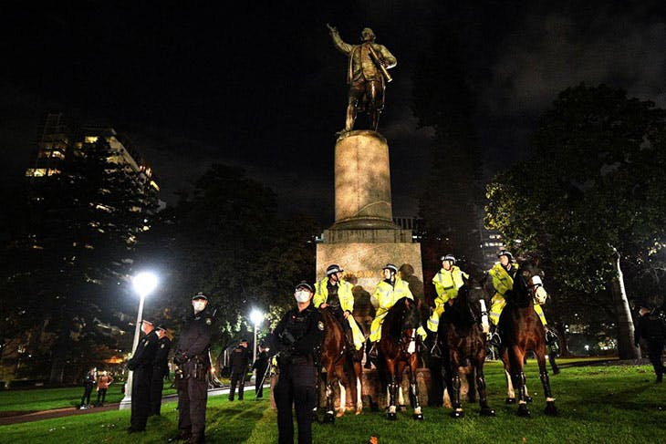 Police guarding the statue of Captain Cook in Hyde Park during a Black Lives Matter protest in Sydney in June 2020.