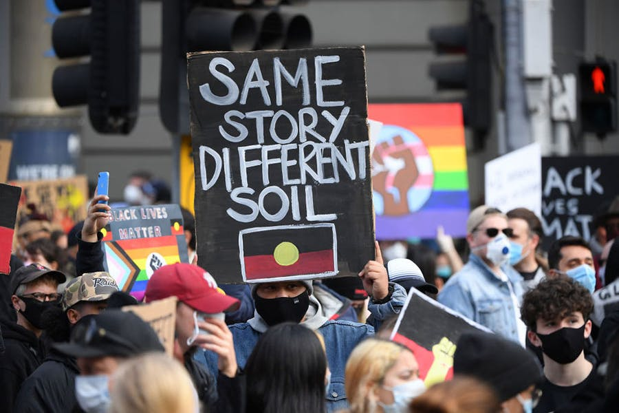 Protesters at a Black Lives Matter rally in Melbourne in June 2020. A number of issues have been raised at recent protests, including the destruction of heritage like the Juukan Gorge sites, the number of Indigenous people who have died in custody over the past three decades, and Australia's colonial history.