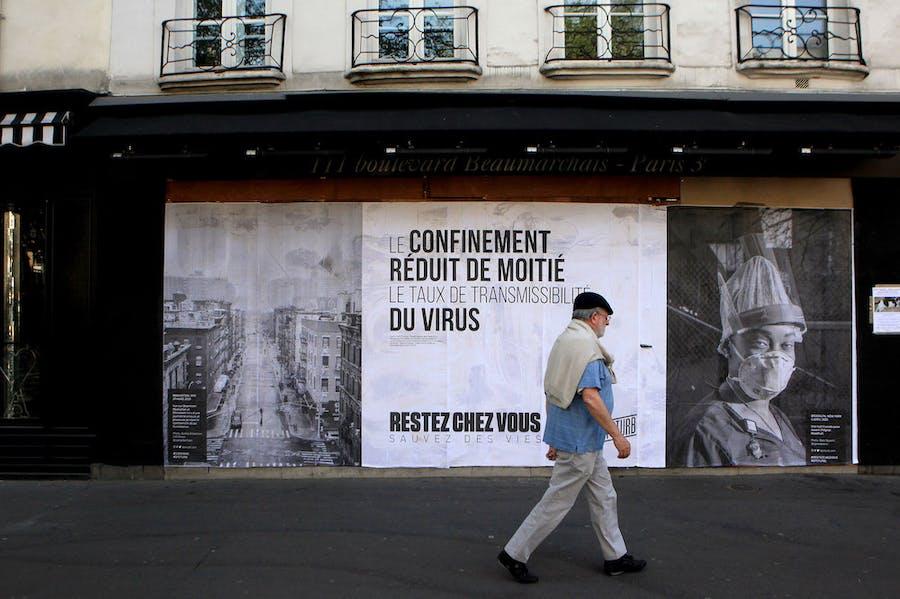 Pasted photographs by Gaia Squarci (Prospekt), and Ashely Gilbertson (VII) on Boulevard des Filles du Calvaire, Paris, 2020.