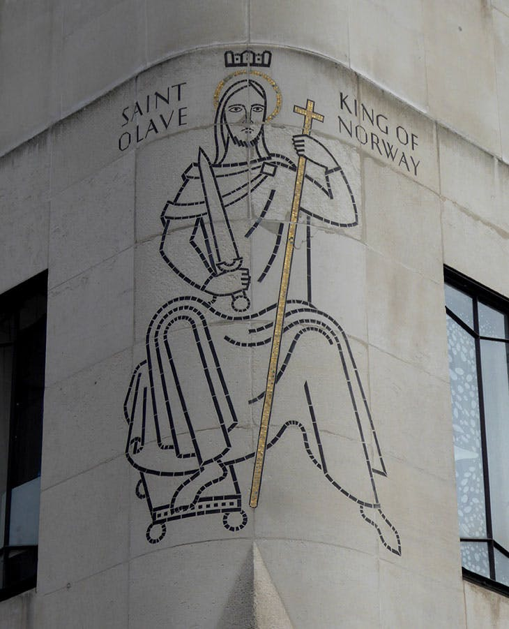 The mosaic designed by Frank Dobson on the exterior of St Olaf House in London.