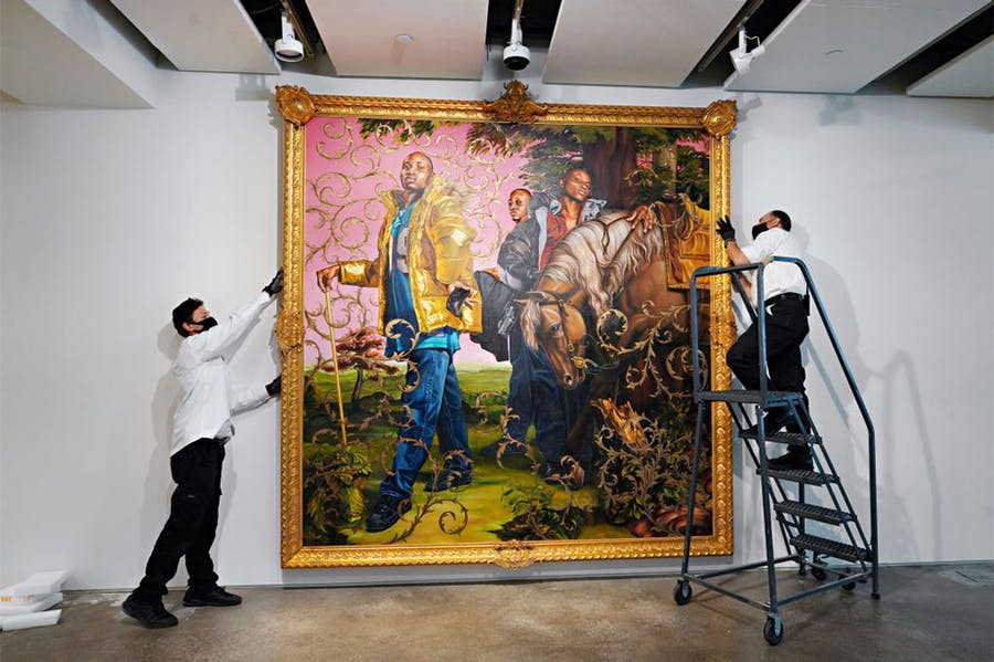 Art handlers preparing Kehinde Wiley's Le Roi à la Chasse II (2007) to be exhibited ahead of auction at Sotheby's New York in June 2020.