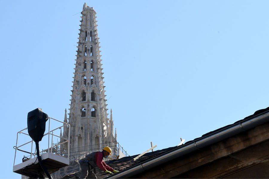 A builder works on the roof of the south tower of Zagreb's cathedral in April 2020 following the 5.3-magnitude earthquake in downtown Zagreb on 22 March. Photo: DENIS LOVROVIC/AFP via Getty Images