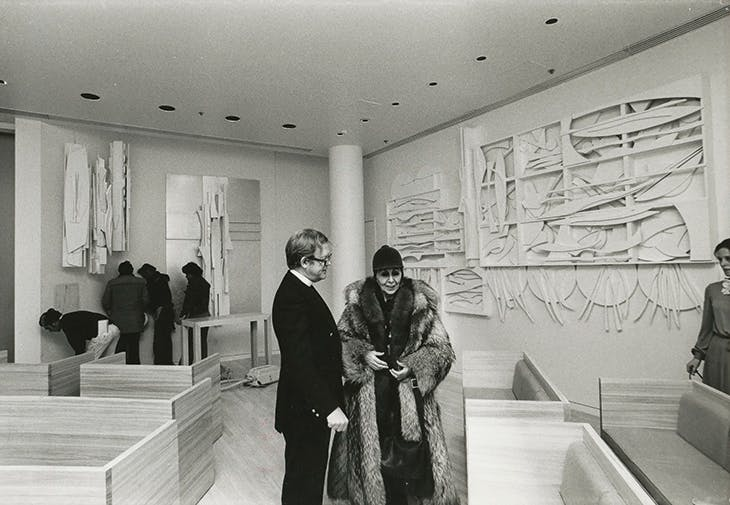 Louise Nevelson with Father Ralph Peterson during an installation of the Chapel of the Good Shepherd, St Peter's Church, New York, designed by Nevelson and dedicated in 1977.