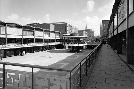 The lower precinct, Coventry, built by the city's Architect's Department in 1957–60 and connecting to the upper precinct and the cathedral beyond (photographed in 1960).