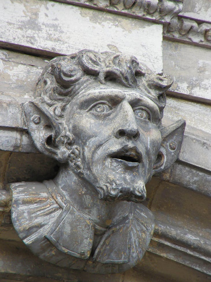 A grotesque face, said to represent Oliver Cromwell, on the facade of the early 18th-century Guidhall, Worcester.