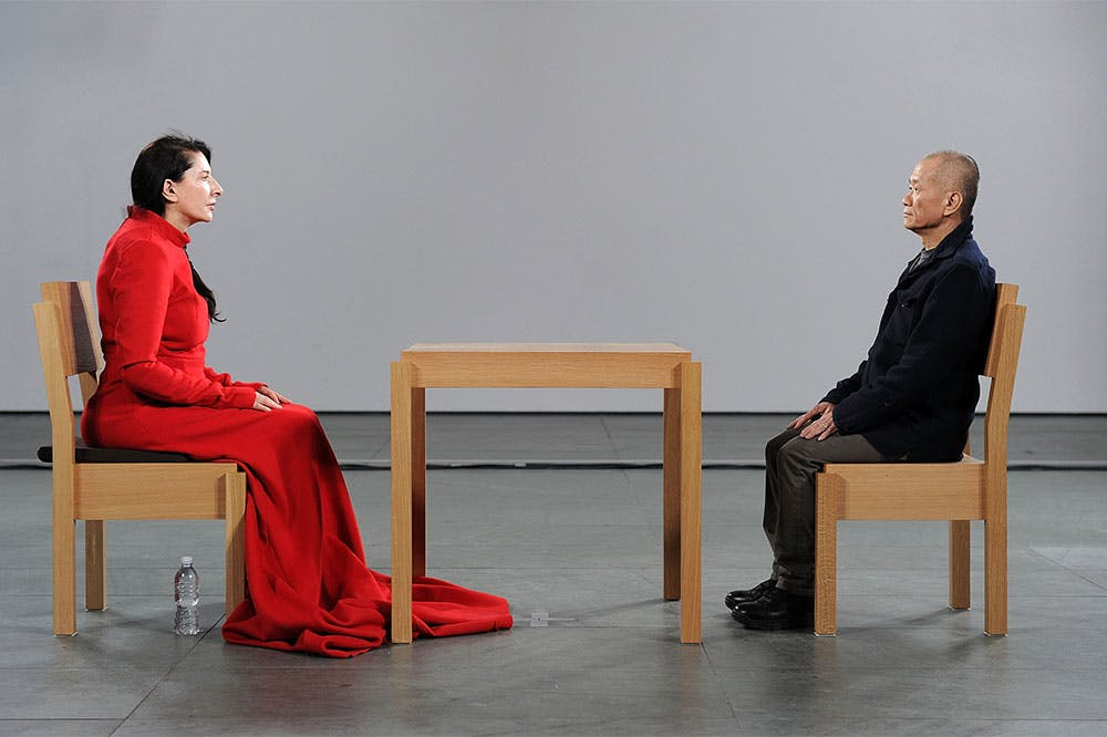 Marina Abramović performing The Artist Is Present at the Museum of Modern Art, New York, 2010.