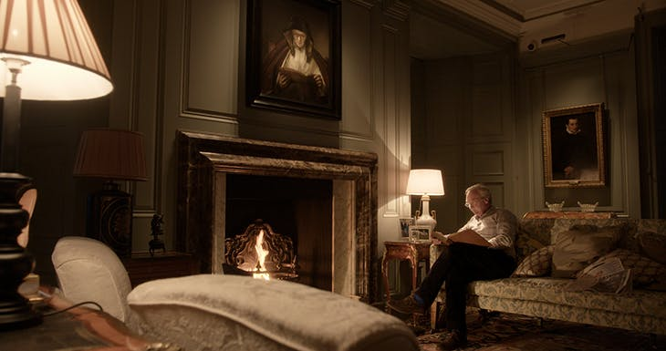 The Duke of Buccleuch at home in Dumlanrig Castle. Above the fireplace hangs 'An Old Woman Reading' by Rembrandt. Courtesy Dogwoof