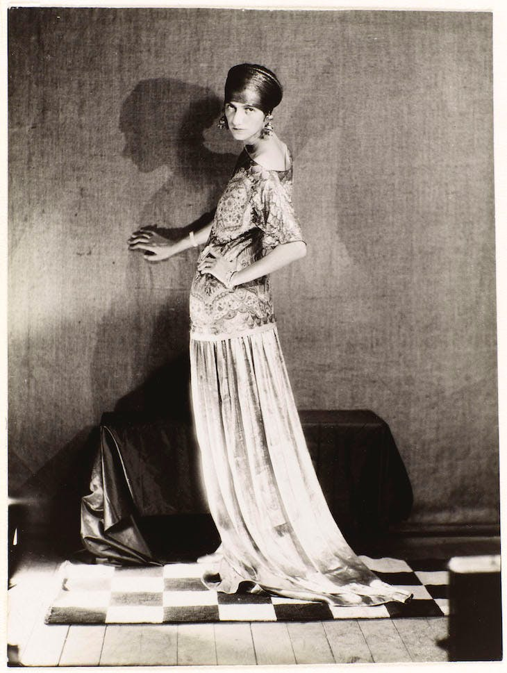 Peggy Guggenheim in a dress by Poiret (1924), Man Ray.