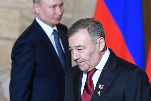 Arkady Rotenberg, who together with his brother Boris Rotenberg has been accused by a US Senate report of evading sanctions by buying art at auction in New York, at an awards ceremony with President Putin in Russia in March 2020.