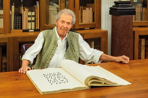 Franco Maria Ricci, photographed in the library of his home near the Labirinto della Masone in Fontanellato, near Parma, in July 2019.
