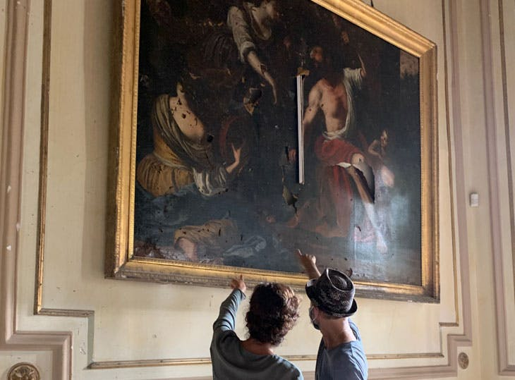 Audrey Azoulay, director-general of Unesco, and Gregory Buchakjian examining 'Hercules and Omphale' at the Sursock Palace in the aftermath of the 4 August blast. Photo: Georges Boustany