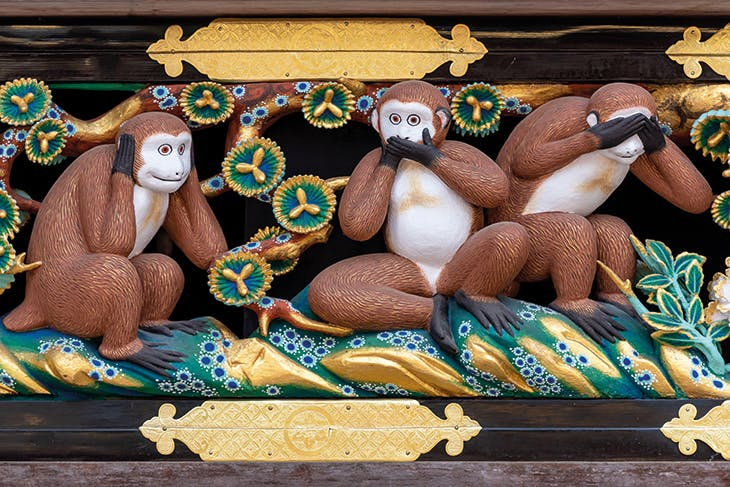 Carved monkeys in a panel on the facade of the sacred horse stable at Nikko (photo: 2019).