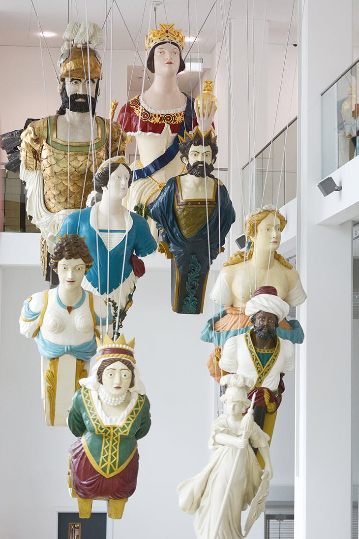 A collection of 19th-century naval figureheads, installed in the entrance hall at the Box, Plymouth.