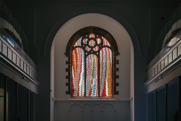 The fused glass window designed by Leonor Antunes and installed in St Luke's Church, the Box, Plymouth.