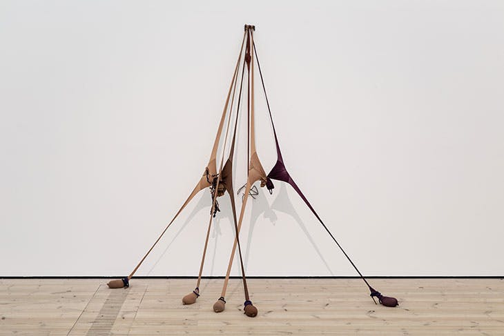 """Installation view of 'The Making of Husbands: Christina Ramberg in Dialogue' at BALTIC Centre for Contemporary Art, Gateshead, 2020. Pictured is Senga Nengudi's R.S.V.P Reverie """"Scribe"""" (2014)."""