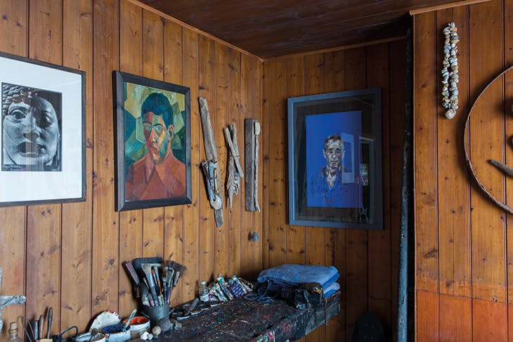 The interior of Prospect Cottage, showing artworks and natural and salvaged objects