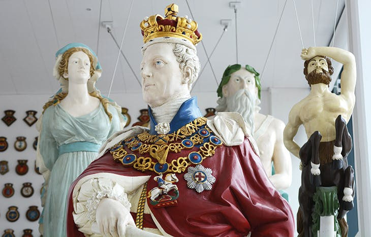 A collection of 19th-century naval figureheads, installed in the entrance hall at the Box, Plymouth. Photo: Wayne Perry