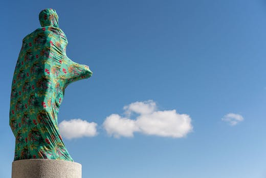 The Cloaking of the statue of Christopher Columbus behind the Bayfront Park Amphitheatre, Miami, Florida (2019), Joiri Minaya.